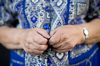 """27 October, 2008. New York. The hands of Faina El'man Ryzhikova, 82, a Jewish holocaust survivor and guerilla fighter, who is here in front of the building where she lives, in Bensonhurst, Brooklyn, NY. After asking for help, the Edith and Carl Marks Jewish Community House of Bensonhurst assisted her by tapping The New York Times Needieset funds for utility expenses of $50/month for 6 months, the first grant starting on October 3, 2008.<br /> <br /> Faina Ryzhikova was born in 1926 in Radoshkovichi, a little village 22 miles northwest from Minsk, Belarus. Back in 1939, this territory belonged to Poland. When the Germans occupied Radoshkovichi, in 1941, they created a ghetto, where Faina and her family lived and worked. In order to escape a planned pogrom by the Germans in 1942, Faina escaped into the forest where she later met the partisans of the brigade """"Narodnie Mstiteli"""" (Avengers of the people), which she joined.<br /> <br /> Faina's mother and sisters were killed while trying to escape. Her father survived and joined aina in 1943. Of the 2000 people that lived in the Radoshkovichi ghetto, only 18 survived. She married Vladimir Ryzhikov in 1954 and raised two sons. Faina's husband passed away in 1991, before the family came to the United States.<br /> <br /> <br /> ©2008 Gianni Cipriano for The New York Times<br /> cell. +1 646 465 2168 (USA)<br /> cell. +1 328 567 7923 (Italy)<br /> gianni@giannicipriano.com<br /> www.giannicipriano.com"""
