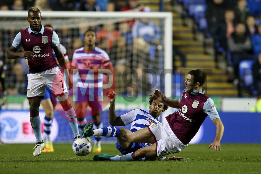 Gary Gardner of Aston Villa sliding tackle on Daniel Williams of Reading - Mandatory by-line: Jason Brown/JMP - 18/10/2016 - FOOTBALL - Madejski Stadium - Reading, England - Reading v Aston Villa - Sky Bet Championship