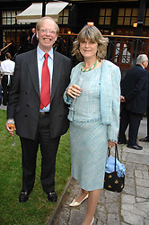 The EARL OF CAITHNESS and LADY SUSIE ROSS at a reception for the Friends of The Castle of Mey held at The Goring Hotel, London on 20th May 2008.<br />