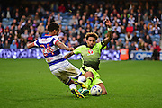 Reading midfielder Danny Williams (23) slides in to Queens Park Rangers defender James Perch (24) during the EFL Sky Bet Championship match between Queens Park Rangers and Reading at the Loftus Road Stadium, London, England on 15 October 2016. Photo by Jon Bromley.