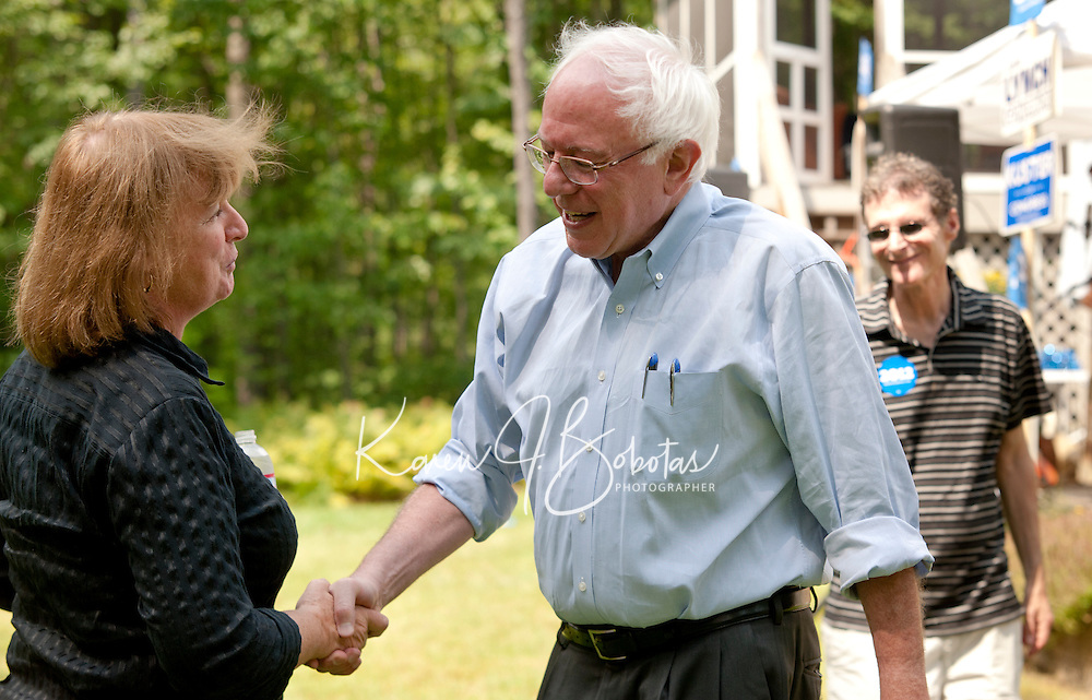 Carol Shea-Porter and Senator Bernie Sanders during the Merrimack County Democrats informal BBQ in Canterbury on Sunday afternoon.  (Karen Bobotas/for the Concord Monitor)