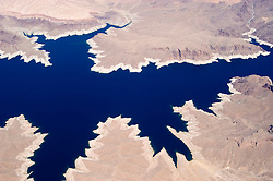 Aerial of Lake Mead and land erosion  behind Hoover Dam on border of Arizona, AZ, Nevada, NV, image nv442-18529.Photo copyright: Lee Foster, www.fostertravel.com, lee@fostertravel.com, 510-549-2202