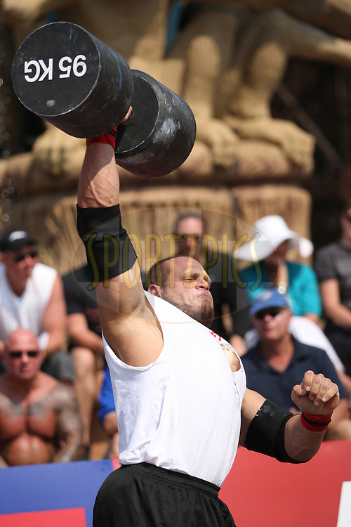 Travis Ortmayer (USA) shows his strength during the dumbell overhead lift, one of the qualifying rounds of the World's Strongest Man competition held in Sun City, South Africa.