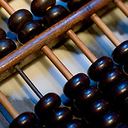 Macro closeup of wooden abacus beads (Shanghai, China - Sep. 2008) (Image ID: 080927-1411484a)