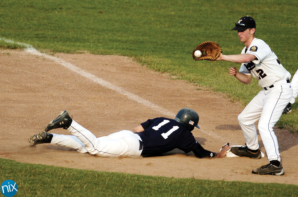 Kannapolis' Daniel Welch catches the ball as Stanly's Jordan Sells slides into first base Monday night in Kannapolis.