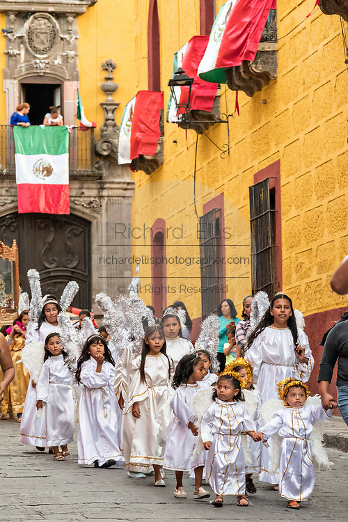 Children dressed as angels escort a statue of Saint Michael in a religious procession through the city at the start of the week long fiesta of the patron saint Saint Michael  September 21, 2017 in San Miguel de Allende, Mexico.