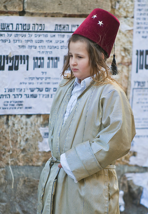 JERUSALEM - MARS 09 : Ultra Orthodox costumed boy during Purim in Mea Shearim Jerusalem on Mars 09 2012 , Purim is a Jewish holiday celebrates the salvation of the jews from jenocide in ancient Persia.
