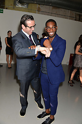Left to right, FRANCOIS-HENRY BENNAHMIAS ceo Audemars Piguet and TINIE TEMPAH at the Audemars Piguet Royal Oak Offshore 42mm Party held at Victoria House, Bloomsbury Square, London on 23rd April 2014.