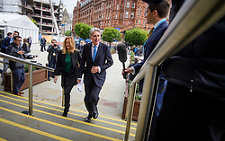 © Licensed to London News Pictures. 02/10/2017. Manchester, UK. Chancellor PHILIP HAMMOND and his wife SUSAN WILLIAMS-WALKER arrive at the conference hall ahead of his speech, on the second day of the Conservative Party Conference. The four day event is expected to focus heavily on Brexit, with the British prime minister hoping to dampen rumours of a leadership challenge. Photo credit: Ben Cawthra/LNP