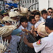 People try to force their way into a football stadium to watch buffalo fighting in Do Son, Vietnam, 27 September, 2009. Do Son, a popular beach-side town three hours east of Hanoi, plays host to an annual Buffalo Fighting Festival every autumn, with water buffalo and their entourage of farmers and trainers arriving from all over the mountainous north, where they have been in isolated training for months..The bulls are led into a football stadium and lock horns, the victor eventually chasing the vanquished out of the grounds to thunderous applauds from thousands of spectators, most of whom are betting heavily on the fights. The buffalo - both winners and losers - are then slaughtered outside the stadium, with their prize-fighting meat fetching up to $50 per kilogram for their owners.