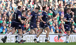 Scotland's Blair Kinghorn celebrates scoring his sides first try during the NatWest Six Nations match at the Aviva Stadium, Dublin.