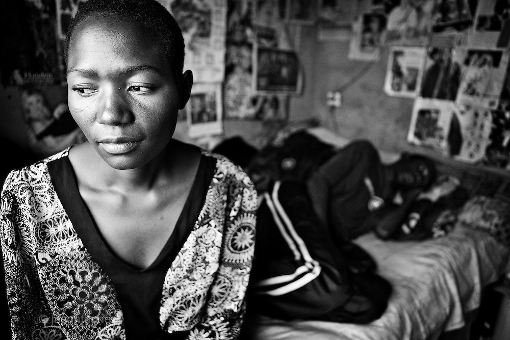 Mrs Pauline Moyo (26 years old) watches over her husband, Tatatza Tiutanhira, 28 years old from Unit O District in the suburb of Chitungwiza suffering from Cholera at his home he shares with his wife and 15 other persons.