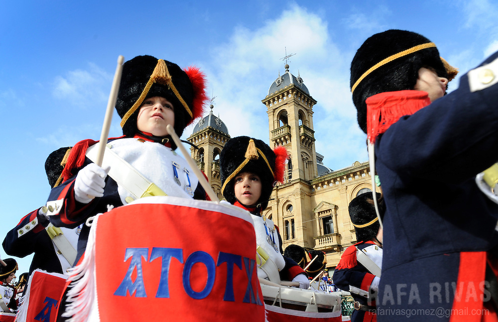 Some children march in front of Town Hall as they take part in San Sebastian's Tamborrada. Some thousands soldiers-clad children march and play drums, on January 20, 2010, during a parade to celebrate San Sebastian's day, the northern Spanish Basque city of San Sebastian's main feast. PHOTO / RAFA RIVAS