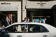 Passers-by admiring a Bentley car parked  on Clifford Street that adjoins to Bond Street in Mayfair. The street, consisting of two sections, has been a fashionable shopping street since the 18th century and is the home of many fashion shops that sell expensive items. Bond Street is one of the most expensive strips of real estate in the world[1] and, in 2010, it was Europe's most expensive retail location.