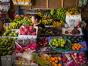 10 OCTOBER 2016 - UBUD, BALI, INDONESIA:  A fruit vendor in the market in Ubud. The morning market in Ubud is for produce and meat and serves local people from about 4:30 AM until about 7:30 AM. As the morning progresses the local vendors pack up and leave and vendors selling tourist curios move in. By about 8:30 AM the market is mostly a tourist market selling curios to tourists. Ubud is Bali's art and cultural center.     PHOTO BY JACK KURTZ