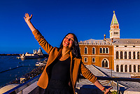 A Ukranian tourist jumps for joy atop the Hotel Danieli rooftop terrace, Venice, Italy.