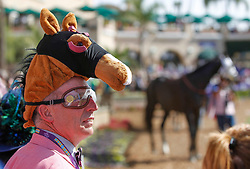 November 3, 2017 - Del Mar, California, U.S. - JOE CONFORTO, from the Bay area, wears a horse hat as he watches horses being walked in the paddock area before the second race during the Breeders' Cup at the Del Mar racetrack in Del Mar on Friday. (Credit Image: © Hayne Palmour Iv/San Diego Union-Tribune via ZUMA Wire)