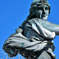 Goddess Gefjion Statue in Copenhagen, Denmark<br /> This close up of the Norse goddess Gefjion is at the summit of a major water fountain in Chruchillparken.  She is best known for creating the island of Zealand.  However, she is also associated with virginity.  According to legend, all those who die chaste become her attendant.  This statue by Anders Bundgaard was unveiled in 1908.