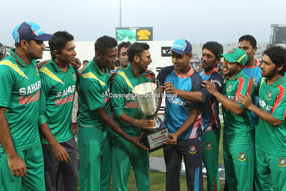 Bangladesh with the one day cup, New Zealand Black Caps v Bangladesh, 1st and only T20 international cricket match at Shere Bangla National Stadium, Mirpur, Bangladesh. 6 November 2013. Photo: Shamsul Hoque Tanku/Photosport.co.nz