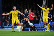 Simon Cox of Southend United is held back by Rob Dickie of Oxford United during the EFL Sky Bet League 1 match between Southend United and Oxford United at Roots Hall, Southend, England on 6 October 2018.