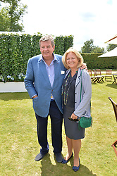 MR & MRS JOHANN RUPERT at the Cartier hosted Style et Lux at The Goodwood Festival of Speed at Goodwood House, West Sussex on 29th June 2014.