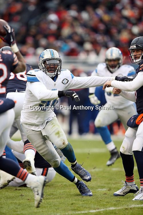 Detroit Lions defensive end Ezekiel Ansah (94) makes a hard cut as he chases the action during the NFL week 17 regular season football game against the Chicago Bears on Sunday, Jan. 3, 2016 in Chicago. The Lions won the game 24-20. (©Paul Anthony Spinelli)