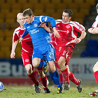 St Johnstone v Brechin....22.03.11  Scottish Cup Quarter Final replay<br /> Murray Davidson battles with Craig Molloy<br /> Picture by Graeme Hart.<br /> Copyright Perthshire Picture Agency<br /> Tel: 01738 623350  Mobile: 07990 594431