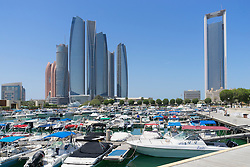 Skyline view of Etihad Towers from luxury hotel marina in Abu Dhabi in United Arab Emirates
