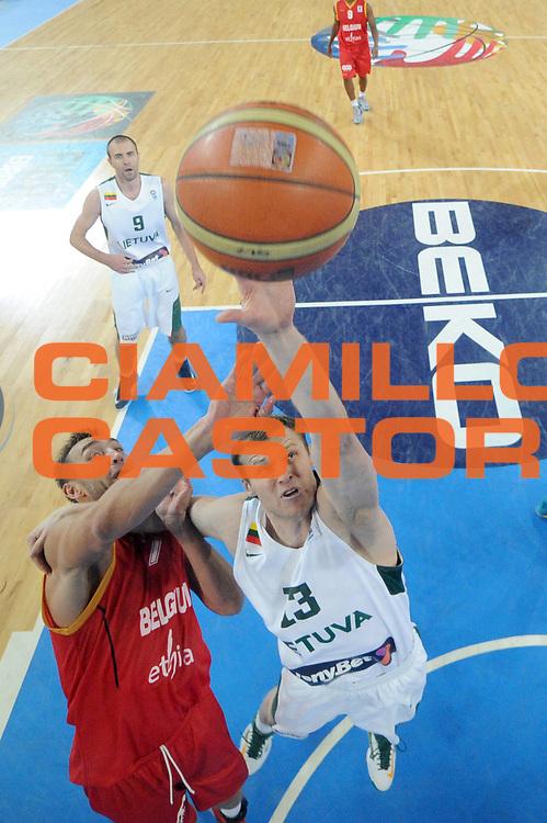 DESCRIZIONE : Lubiana Ljubliana Slovenia Eurobasket Men 2013 Second Round Lituania Belgio Lithuania Belgium<br /> GIOCATORE : Martynas Pocius <br /> CATEGORIA : rimbalzo rebound special<br /> SQUADRA : Lithuania Lituania<br /> EVENTO : Eurobasket Men 2013<br /> GARA : Lituania Belgio Lithuania Belgium<br /> DATA : 13/09/2013 <br /> SPORT : Pallacanestro <br /> AUTORE : Agenzia Ciamillo-Castoria/C.De Massis<br /> Galleria : Eurobasket Men 2013<br /> Fotonotizia : Lubiana Ljubliana Slovenia Eurobasket Men 2013 Second Round Lituania Belgio Lithuania Belgium<br /> Predefinita :