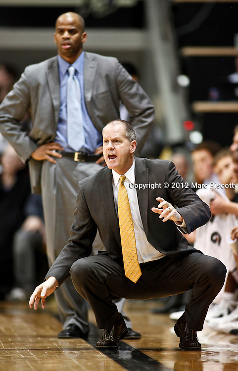 SHOT 1/21/12 6:23:28 PM - Colorado head basketball coach Tad Boyle coaches against Arizona during their PAC 12 regular season men's basketball game at the Coors Events Center in Boulder, Co. Colorado won the game 64-63..(Photo by Marc Piscotty / © 2012)