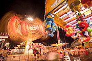 Oct. 21, 2009 -- PHOENIX, AZ: A time exposure of the Zipper ride on the midway at the Arizona State Fair in Phoenix, AZ. The fair runs through November 8.   Photo by Jack Kurtz