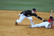 Austin Peay's Jordan Hankins tags out Ole Miss' Tanner Mathis (12) on a steal attempt in the first inning at Oxford-University Stadium in Oxford, Miss. on Wednesday, March 2, 2010.