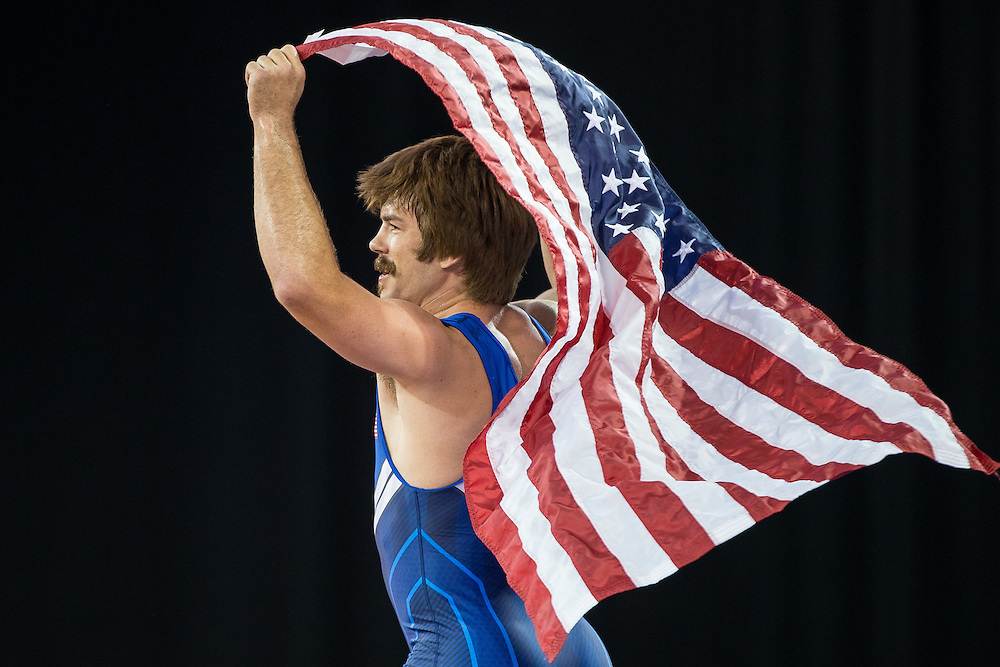 Gold medalist Andrew Bisek of the United States celebrates his win over Alvis Almendra of Panama in the 75kg class of the men's greco-roman wrestling at the 2015 Pan American Games in Toronto, Canada, July 15,  2015.  AFP PHOTO/GEOFF ROBINS