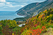 The Cabot Trail along the Gulf of St. Lawrence meanders through the Acadian forest in autumn foliage<br />