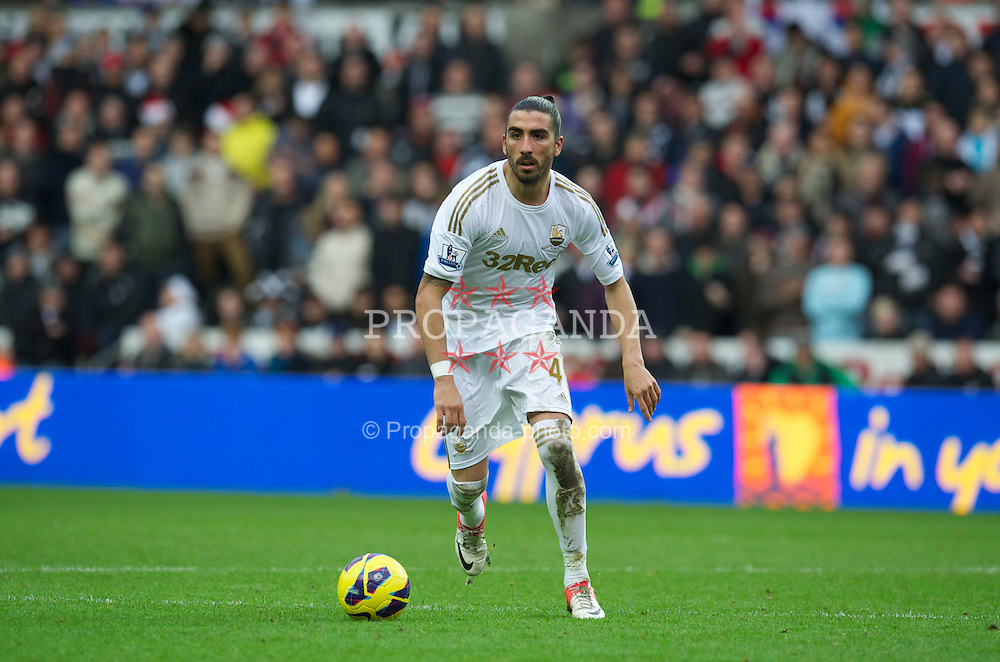 SWANSEA, WALES - Sunday, December 23, 2012: Swansea City's Chico Flores in action against Manchester United during the Premiership match at the Liberty Stadium. (Pic by David Rawcliffe/Propaganda)