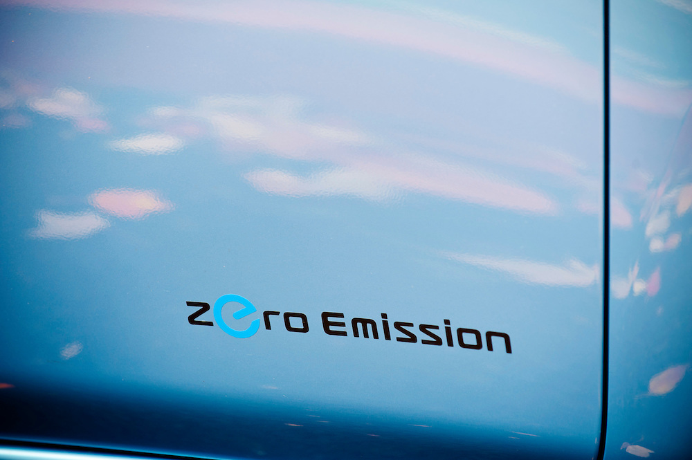 "The 100% electric Nissan LEAF touts ""zero emissions"" on it's door."