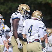 Salesianum Corner Back Mitchell Sgro (4) celebrates with his teammates after returning a interception for a touchdown Saturday, Oct. 17, 2015 at Concord Stadium in Wilmington.