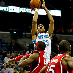 Jan 1, 2013; New Orleans, LA, USA; New Orleans Hornets power forward Anthony Davis (23) shoots over Atlanta Hawks small forward Josh Smith (5) during the second quarter of a game at the New Orleans Arena. Mandatory Credit: Derick E. Hingle-USA TODAY Sports