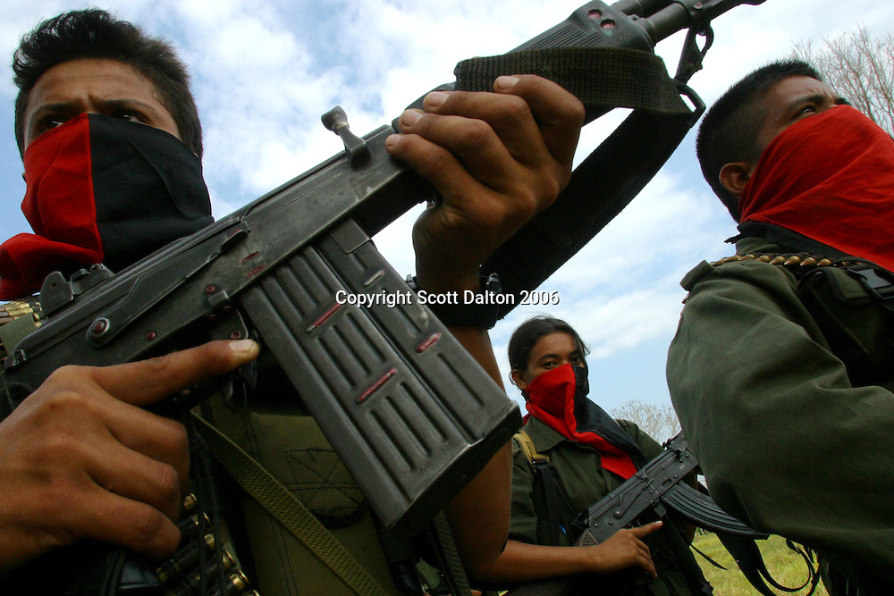 Rebels of the National Liberation Army, ELN, in formation in Arauca. The ELN is the second largest rebel group in Colombia with an estimated 5,000 members. The ELN is most known for carrying out kidnappings and attacking oil pipelines throughout the country. (Photo/Scott Dalton)