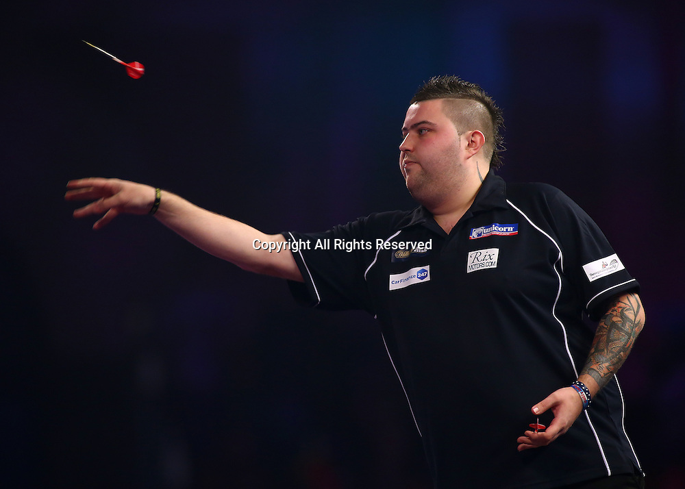 23.12.2016. Alexandra Palace, London, England. William Hill PDC World Darts Championship. Michael Smith throws during the first leg, in his match with Mervyn King