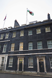 Downing Street, London, February 11th 2016. The Welsh flag flies over Downing Street on St David's Day. <br /> &copy;Paul Davey<br /> FOR LICENCING CONTACT: Paul Davey +44 (0) 7966 016 296 paul@pauldaveycreative.co.uk