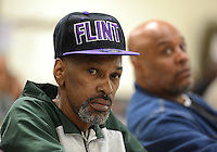 FLINT - MARCH 10: Larry Stafford, 55, a Flint resident listens to Flint City Councilman Eric Mays and other residents talk about their water bills and other water issues during a town hall meeting Thursday, March 10, 2016 at the Hasselbring Community Center on the north side of Flint. City officials say, when the water department's software is updated, people will start seeing credits on their water bills amounting to 65 percent of the water portion of their bills. Residents are still responsible for the sewer fee portions of their bills. (Photo by Bryan Mitchell/Special to The Detroit News)