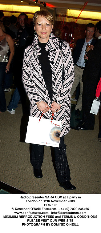 Radio presenter SARA COX at a party in London on 12th November 2003.<br /> POK 105