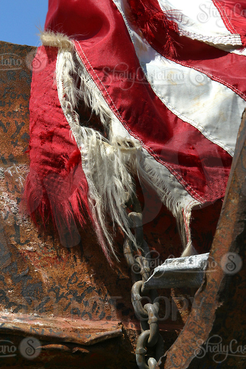Sep 10, 2002; Yorba Linda, California, USA; Tattered American flag lies over rusted chain and steel beams from an exhibit of 9/11 wreckage from the World Trade Center that are on display at the Richard Nixon Library &amp; Birthplace.<br />Mandatory Credit: Photo by Shelly Castellano/ZUMA Press.<br />(&copy;) Copyright 2002 by Shelly Castellano