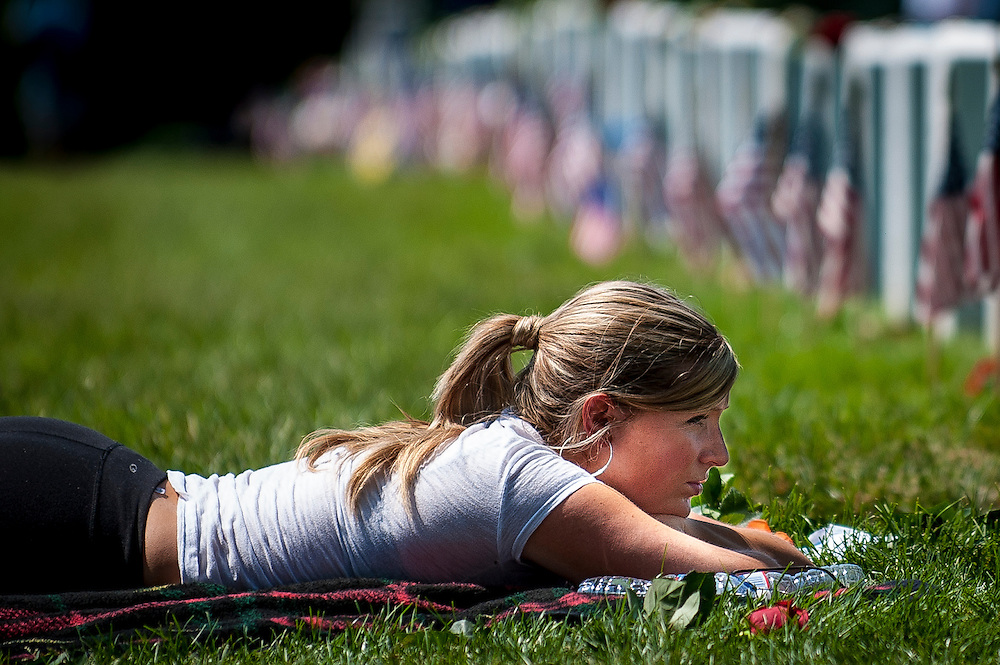 Stephanie Montgomery of Atlanta, GA, lays near the grave of her bother, Army SGT Thaddeus Montgomery on Memorial Day at Arlington National Cemetery in Arlington, VA, USA on 28 May, 2012. This was her first visit to his gravesite.