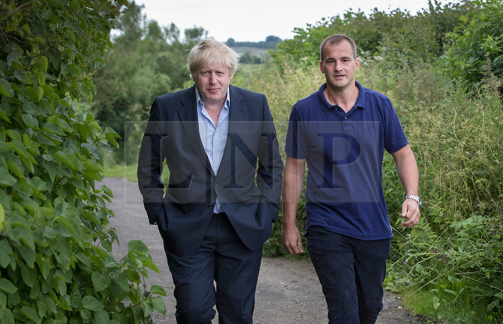 © Licensed to London News Pictures. 26/06/2016. Oxfordshire, UK. Boris Johnson (L) walks with Jake Berry MP at his home in Oxfordshire. Prime Minister David Cameron his holding a cabinet meeting tomorrow after announcing his resignation on Friday. The United Kingdom has voted to leave the EU in an historic referendum.  Photo credit: Peter Macdiarmid/LNP