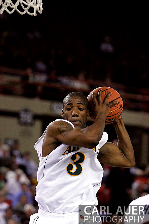 24 November 2005:  University of Alaska Anchorage senior guard Kemmy Burgess grabs a rebound in the UAA Seawolves 60-65 loss to the South Carolina Gamecock's in the first round of the Great Alaska Shootout at the Sullivan Arena in Anchorage Alaska.