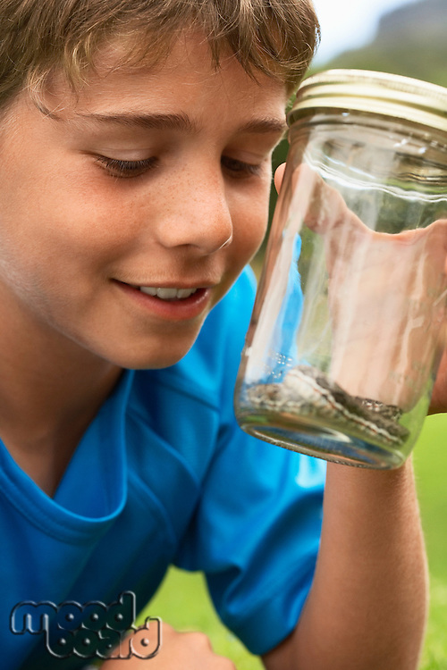 Boy Looking at Snake in Jar