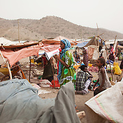 It is Tuesday and market day in Delafagi. People travel from far to sell their goods, to stock-up and to socialise. Hasna is 19 years old and part time health worker trained by AISDA. She spends the morning in the market to advocate stopping the FGM practise, a practice she as a young woman only knows too well the consequences of. She uses a megaphone and she does not mince her words, when she proclaims that 'salot', the Afar word for mutilation of the female genitals is bad and a wrong practice and must be stopped.  Action for Integrated Sustainable Development Association (AISDA) work in the AFAR region of Eastern Ethiopia, based in Delafagi. The Afars practise an old tradition of Female Genital Mutilation where the baby girls has her clitoris and labia cut away and her vagina sewn up. The day before her wedding day the girl is un-stiched ready for marriage. Its a brutal and barbaric tradition which AISDA is challenging with great effect, now more than a hundred girls in Dowe district have been saved from the knife and AISDA is now rolling out the scheme in Delafagi. Delafagi is where the oldest ever human remains have been found, the found is thought to be 4.5 mill years old.