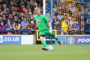 AFC Wimbledon goalkeeper George Long (1) making a clearance during the EFL Sky Bet League 1 match between AFC Wimbledon and Shrewsbury Town at the Cherry Red Records Stadium, Kingston, England on 12 August 2017. Photo by Matthew Redman.